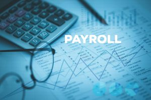payroll concept glasses calculator paper